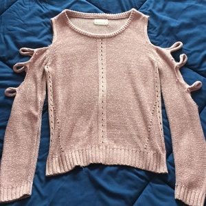 pink and white shoulder-less knit sweater.